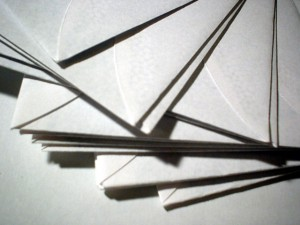 a stack of letter envelopes