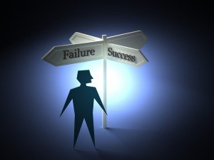 Stick figure standing by a sign that says Failure and Success pointing in two different directions, symbolizing the need for church leadership to make quick and fast decisions by defining the problem first and moving to a solution.