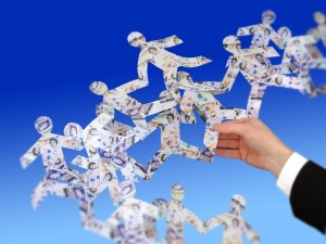 image resembling a person holding several paper money people interwined with each other