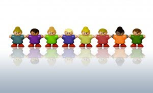 Toy kids standing hand to hand resembling church members