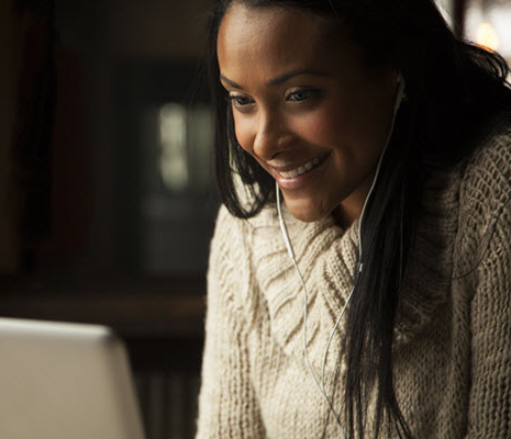 Church software technician with a head set listening through her computer to a support question from a user.