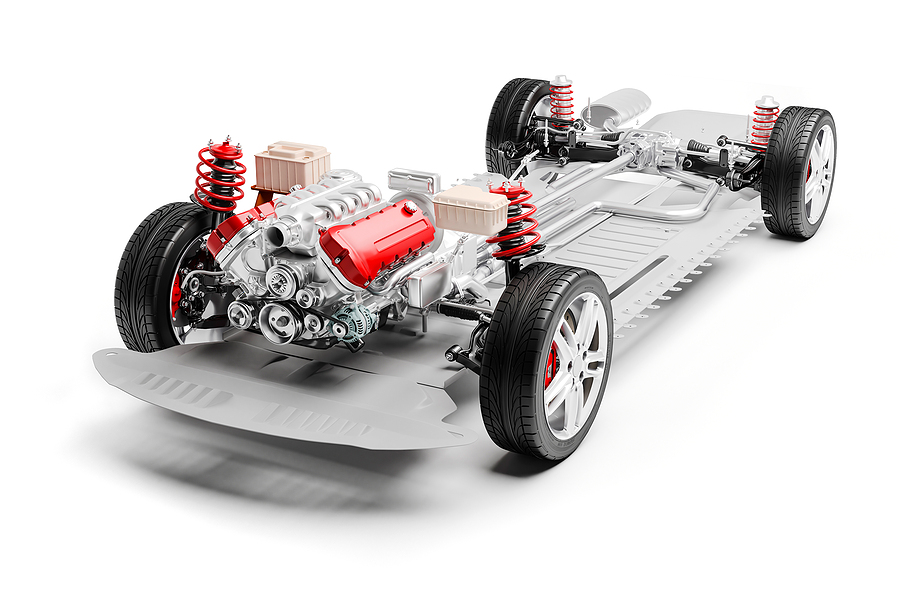 3d car chassis with motor, wheels and suspension, on white background.