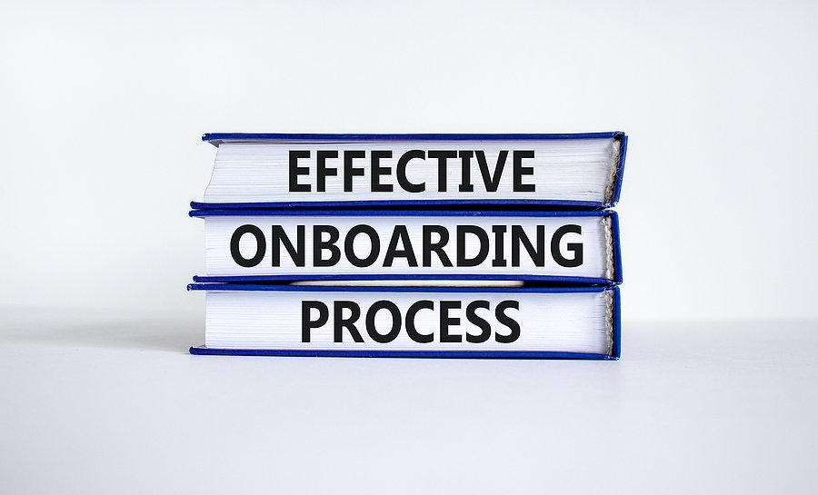 Three books with the words 'effective onboarding process' on the edge of the books.